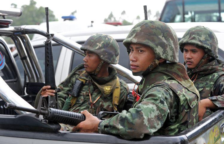 Thai soldiers guard during a visit by Thai Prime Minister Abhisit Vejjajiva after a deadly exchange of gunfire between Thai and Cambodian soldiers near the border on April 27. (Pornchai Kittiwongsakul/AFP/Getty Images)
