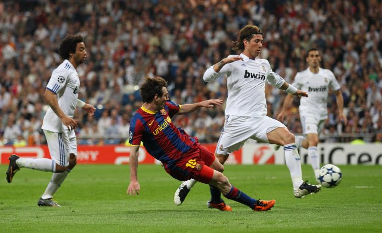 Lionel Messi of Barcelona scores his second goal during the UEFA Champions League semifinal first leg match between Real Madrid and Barcelona at Estadio Santiago Bernabeu on Wednesday. (Alex Livesey/Getty Images)
