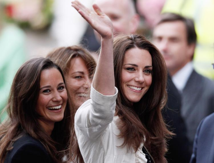 Catherine Middleton (R) spends her last day as a commoner on Thursday with her mother Carole and sister Philippa outside The Goring Hotel in London. Middleton and her fiance, Prince William, released their official wedding program on Thursday. (Christopher Furlong/Getty Images)