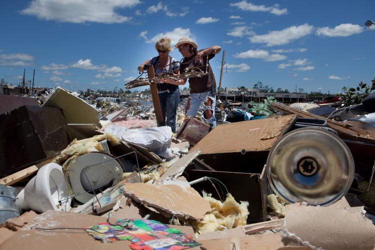 In the aftermath of Wednesday night's storms, Deron Hallman and salon owner Karen Barr (R) try to salvage items from the leveled Hair Shack on April 28, 2011 in Tuscaloosa, Alabama. The tornado-torn state now has 204 confirmed deaths.  (Jessica McGowan/Getty Images)