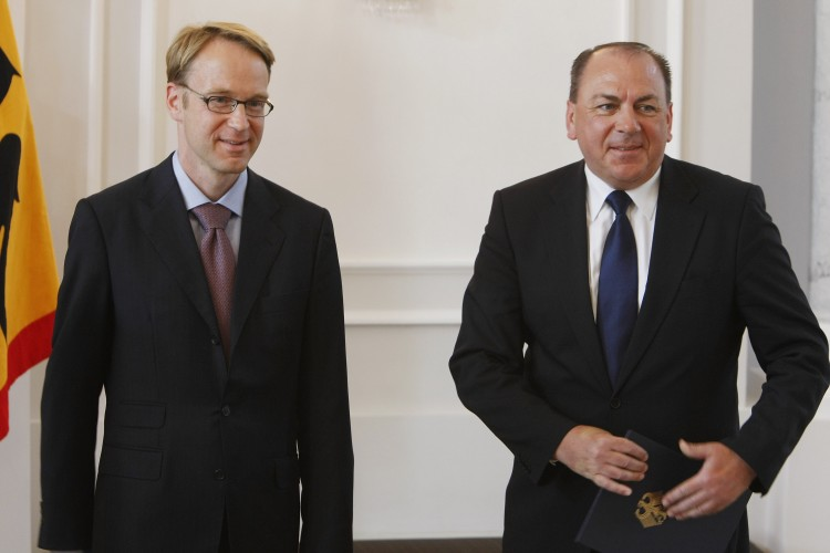 OLD AND NEW: Outgoing Bundesbank President Axel Weber (R) is seen receiving his official discharge papers as new Bundesbank President Jens Weidmann (L) looks on at Bellevue Presidential Palace on April 29 in Berlin, Germany. Weber has joined Swiss bank UB (Carsten Koall/Getty Images )