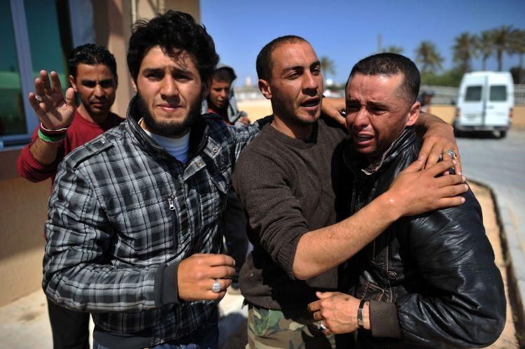 Libyan rebels weep after a comrade was shot in the head at a hospital in Misrata on April 29. (Christophe Simon/AFP/Getty Images)