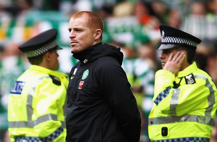 Manager Neil Lennon of Celtic, flanked by police officers, looks on as the crowd sing 'You'll never walk alone' at the end of the Clydesdale Bank Premier League match between Celtic and Motherwell at Celtic Park on May 15, 2011 in Glasgow, Scotland.   ( Paul Gilham/Getty Images)