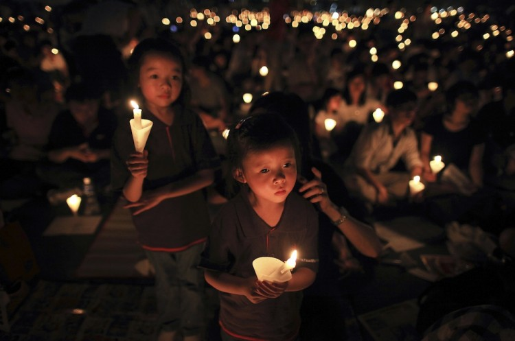 Children hold candles during a vigil marking the anniversary of the Tiananmen Square crackdown, in Hong Kong, on June 4. Thousands of people marked the bloody 1989 crushing of democracy protests in Beijing as China defies international condemnation with a roundup of political dissidents. (Ed Jones/AFP/Getty Images)