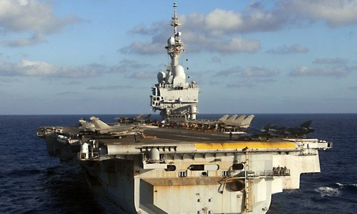 French Charles de Gaulle aircraft carrier sails on June 13, 2011 off the Libyan coast, during the Harmattan operation. (Joel Saget/AFP/Getty Images)