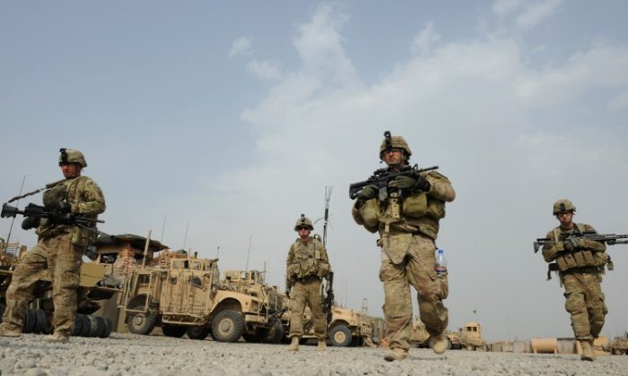 U.S. soldiers from Viper Company (Bravo) 1-26 Infantry head for a foot patrol at Combat Outpost (COP) Sabari in Khost province, east of Afghanistan on June 26, 2011. (Ted Alijibe/AFP/Getty Images)