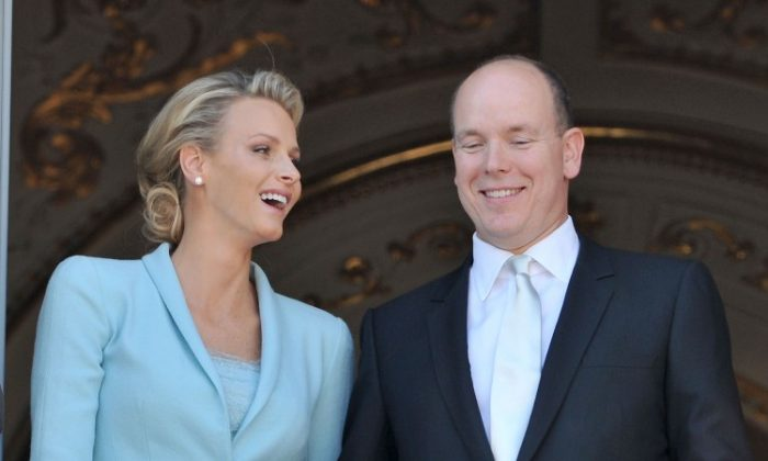 Princess Charlene of Monaco and Prince Albert II of Monaco pose on the balcony after their civil ceremony on July 1, 2011. (Pascal Le Segretain/Getty Images)