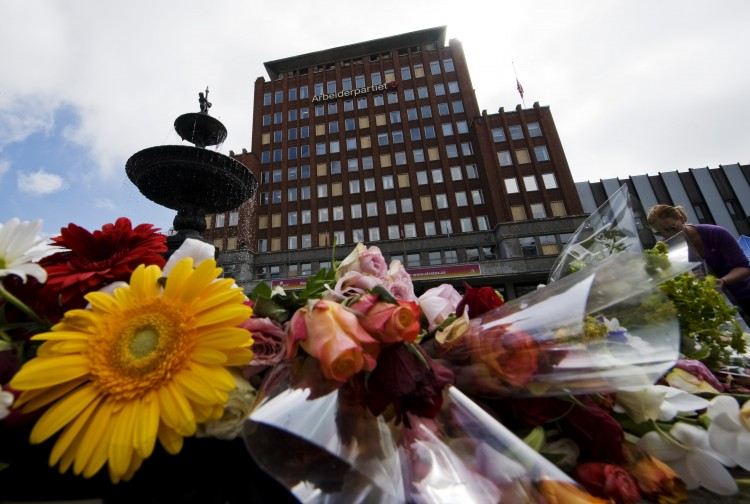 Flowers are placed in front of the damaged Labour Party's headquarters from the July 22 bomb attack in Oslo on July 27, 2011. (Johnathan Nackstrand/AFP/Getty Images)
