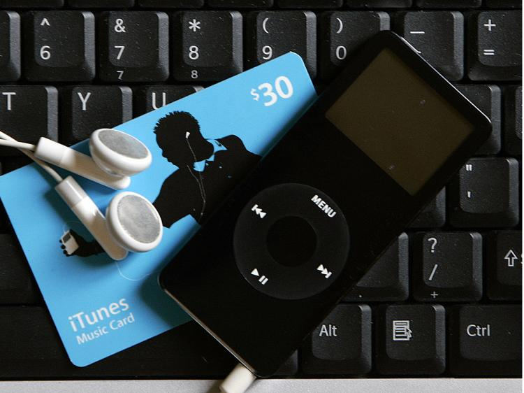 CD NO MORE: Buy tunes with your ITunes music card download to your computer, and listen with your iPod Nano. No packaging, no shipping, no waste.    (Robert Sullivan/AFP/Getty Images)