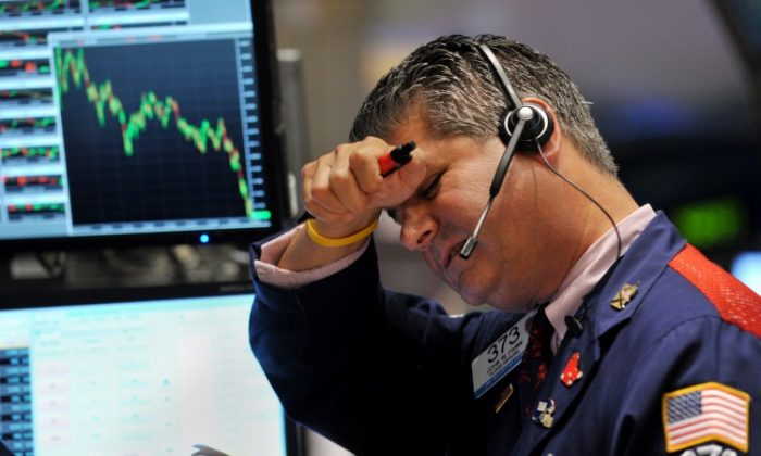 A trader works on the floor of the New York Stock Exchange on Aug. 4, 2011. (Stand Honda/Getty Images)