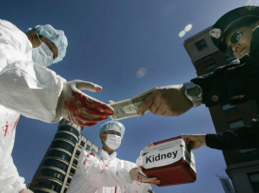 Falun Gong demonstrators dramatize an illegal act of paying for human organs