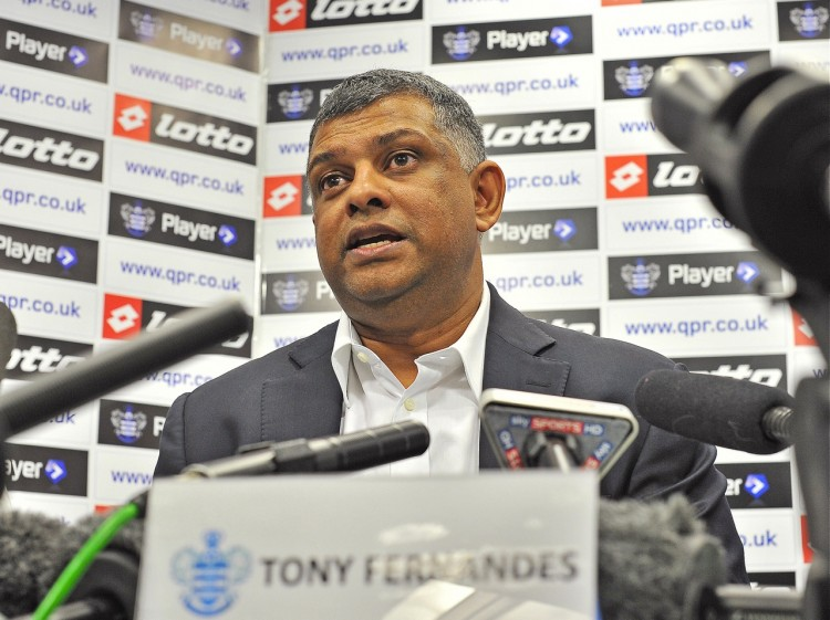 Malaysian tycoon Tony Fernandes addresses a press conference at Queens Park Rangers football club in London, on Aug. 18, 2011. (Carl de Souza/AFP/Getty Images)