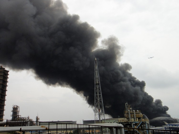 Smoke billows from a fire at Chinese state-owned oil giant PetroChina's largest oil refinery in Dalian, in China's northeastern Liaoning Province, on Aug. 29, 2011.  (AFP/Getty Images)