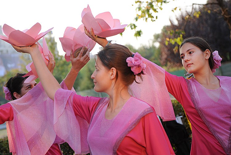Falun Gong members from various countries perform a dance during a demonstration and peaceful protest in downtown Bucharest, on September 24, 2011. A group of Romanians and foreigners marched to the Chinese Embassy aiming to draw the public's attention to the crimes of the Chinese communist regime against Falun Gong members during over 12 years of persecution. (Daniel Mihailescu/AFP/Getty Images)