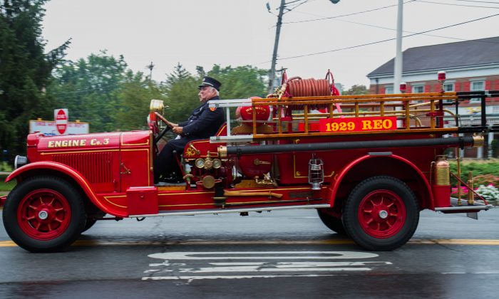 The side of a 1923 REO fire engine from the Warwick Fire Department in the Triennial Fire Parade in Goshen on Sept. 12, 2015. (Holly Kellum/Epoch Times)