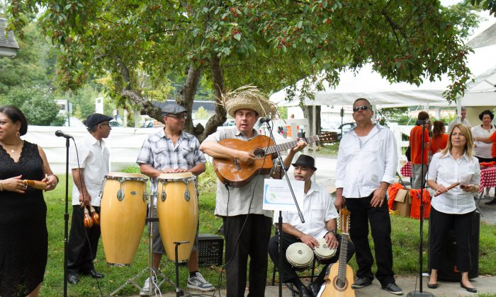 Latin band Los Caribeños performs during Fiesta Latina at Museum Village in Monroe on Sept. 12, 2015. (Holly Kellum/Epoch Times)