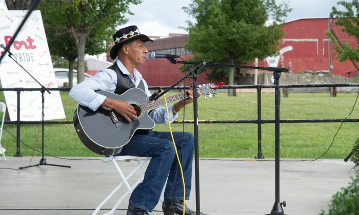 """Vocalist and guitar player Kevin Mann performs """"Neon Moon"""" at the Tri-State Talent show in Riverside Park in Port Jervis on Sept. 13, 2015. (Holly Kellum/Epoch Times)"""