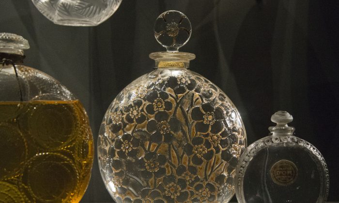 """A """"Clamart"""" perfume bottle designed by Rene Lalique in 1926, is displayed at the Fragonard perfume museum in Paris, France, Friday, Sept. 11, 2015. (AP Photo/Michel Euler)"""