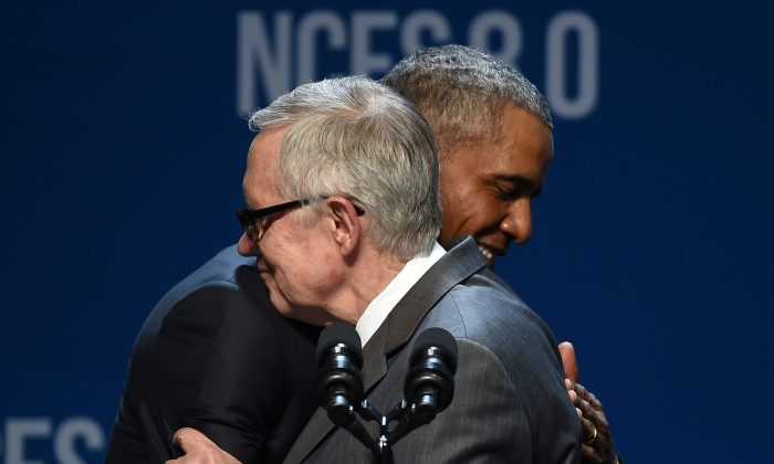 LAS VEGAS, NV - AUGUST 24:  U.S. Senate Minority Leader Harry Reid (D-NV) (L) embraces U.S. President Barack Obama as Reid introduces him for a keynote address at the National Clean Energy Summit 8.0 at the Mandalay Bay Convention Center on August 24, 2015 in Las Vegas, Nevada. Political and economic leaders are attending the summit to discuss a domestic policy agenda to advance alternative energy for the country's future.  (Photo by Ethan Miller/Getty Images)
