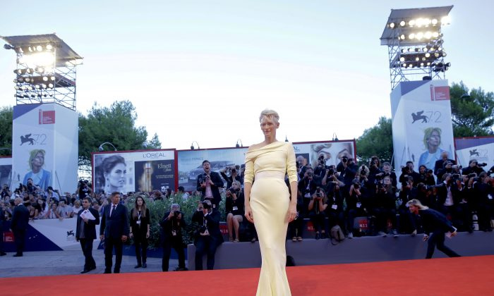 Tilda Swinton poses for photographers at the premiere of the film A Bigger Splash during the 72nd edition of the Venice Film Festival in Venice, Italy, Sunday, Sept. 6, 2015. (AP Photo/Andrew Medichini)