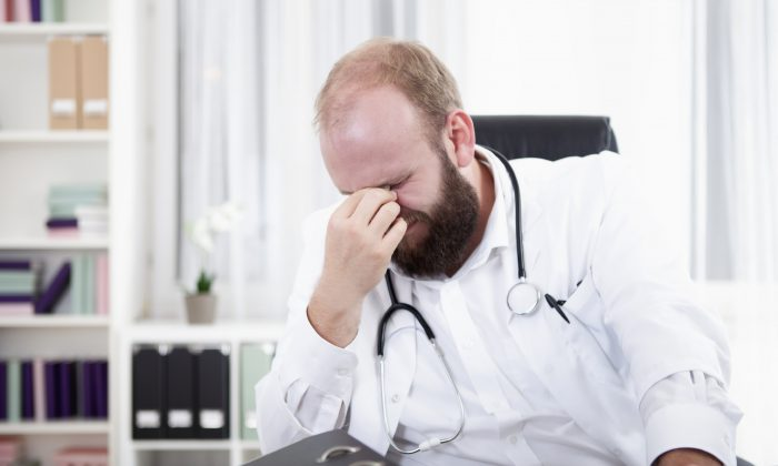 A general practitioner, an ordinary superhero, but under pressure of burnout, depression, and even suicide. (Tuned_In/iStock)