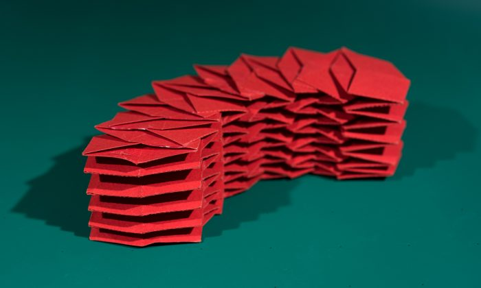This origami structure is composed of 12 interlocking tubes that can fold flat for easy transportation. (Credit: Rob Felt/Georgia Tech)