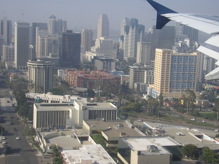 BLACKOUT: An airplane over downtown San Diego gets ready for landing at Lindbergh Field, San Diego's main airport.  (Gisela Sommer/The Epoch Times)