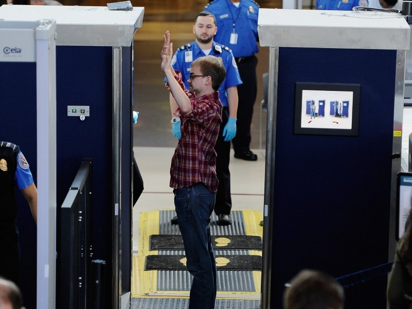 A traveler is screened by a body scanner at the security checkpoint in an airport. (Kevork Djansezian/Getty Images)