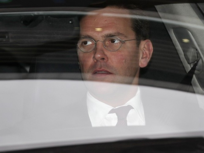 James Murdoch leaves the annual general meeting of BSkyB