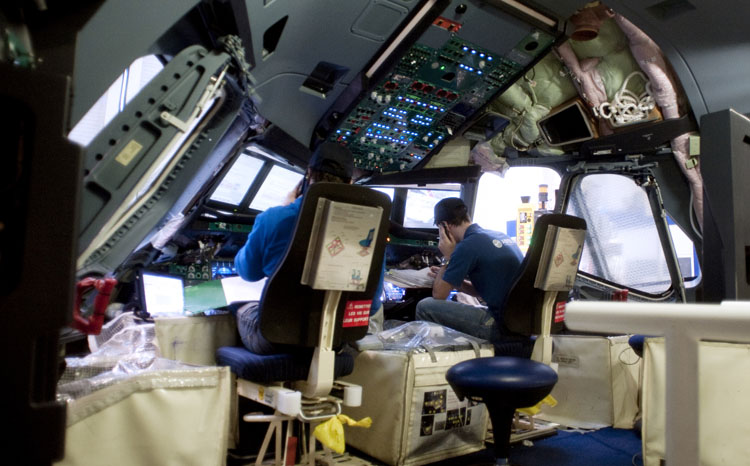 Employees are at work in the cockpit of an A380 plane