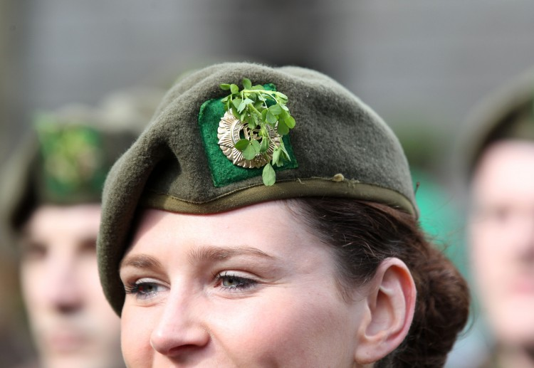 Picture of an Irish female army officer wearing a shamrock in her cap as she marches in the St Patrick's Day festivities in Dublin, Ireland on March 17, 2012.