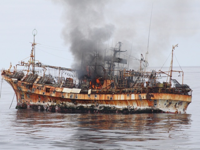 A Japanese fishing vessel Ryou-Un Maru smoulders