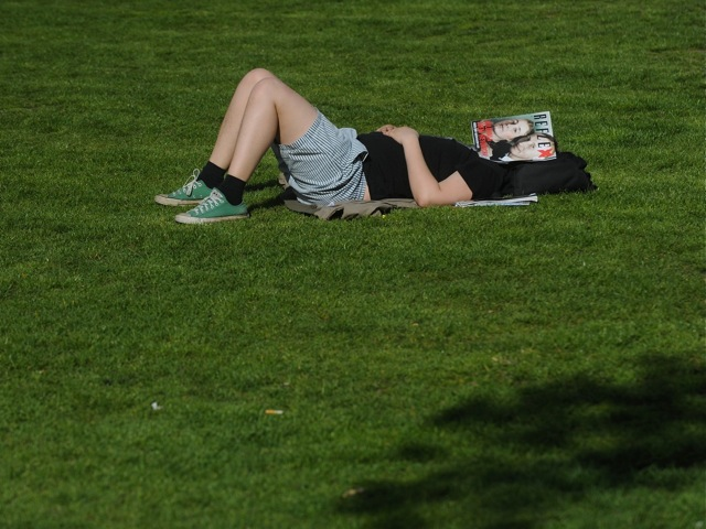 A man sleeps in the grass in April, 2012 in Prague.