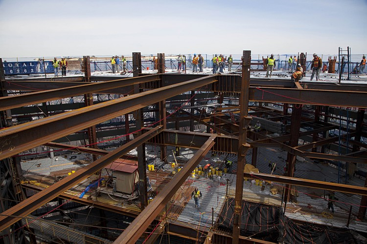 Ironworkers weld steel decking at the top of One World Trade Center