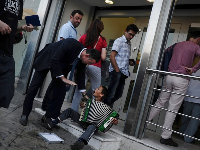 People line up outside a Greek bank