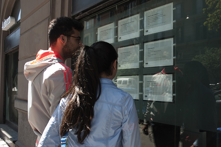 Two people look at job announcements on the window of an agency in Naples on May 3, 2012. Italy's unemployment rate hit a record of 9.8 per cent in March, official data showed on May 2, as a recession in the eurozone's third-biggest economy deepens. (Anna Monaco/AFP/GettyImages)