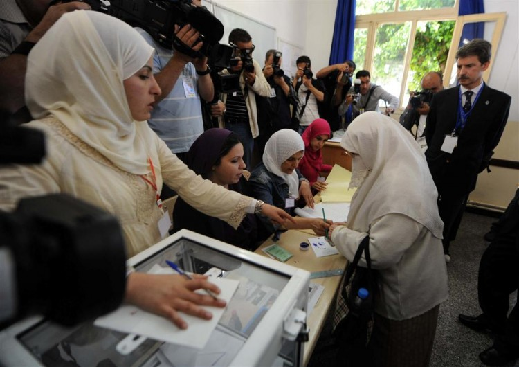 Algerians vote in a polling station in the capital Algiers.