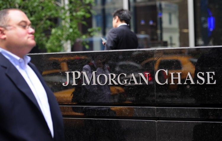 People walk past JP Morgan Chase & Co headquarters in New York, May 14. (Emmanuel Dunand/AFP/GettyImages)