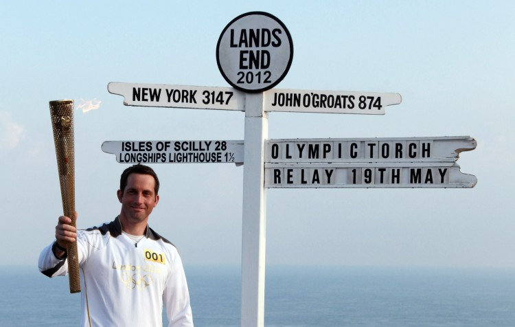 Olympic gold medal sailor Ben Ainslie is the first London 2012 torchbearer. He sets off from the famous Land's End sign post. (Matt Cardy/Stringer/Getty Images Sport)