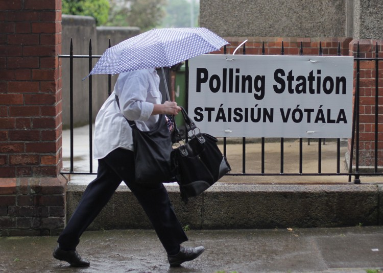 A voter arrives at a polling station to vote in the referendum on the European fiscal treaty in Dublin, Ireland on May 31, 2012.  Ireland is the only one of 25 nations which is putting the fiscal pact to a national vote. The pact, signed by all EU members except the Czech Republic and the UK, allows EU member states to co-ordinate their budget policies and impose penalties on rule-breakers.