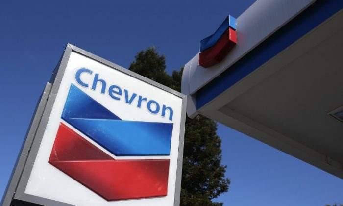 A sign is posted at a Chevron gas station on July 27, 2012 in San Rafael, California. After an explosion at a major Chevron refinery in a city located north of San Francisco on Tuesday, gasoline prices spiked across California and could increase to more than $4 per gallon. (Justin Sullivan/Getty Images)