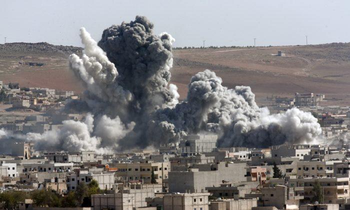 Smoke from an airstrike by the U.S.-led coalition in Kobani, Syria, on Oct. 22, 2014. (AP Photo/Lefteris Pitarakis)