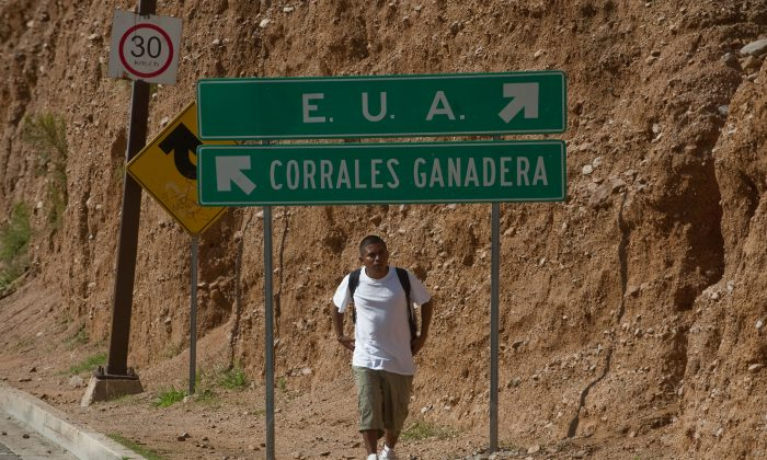 An immigrant-to-be walks near the U.S.-Mexico border, in Nogales, Sonora State, Mexico, on July 28, 2010. (Alfredo Estrella/AFP/Getty Images)