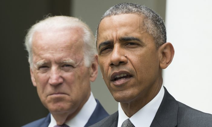 President Barack Obama speaks alongside Vice President Joe Biden about the Supreme Court's ruling to uphold the subsidies that comprise the Affordable Care Act, known as Obamacare, in the Rose Garden of the White House in Washington on June 25, 2015. (Saul Loeb/AFP/Getty Images)
