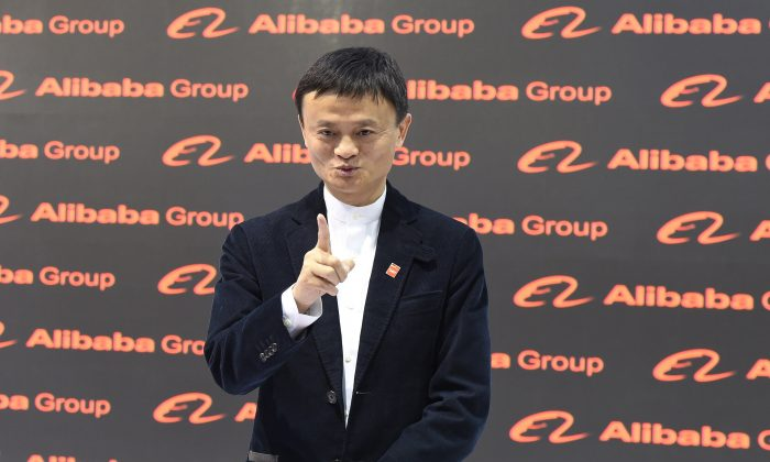 Jack Ma poses for the media at the Alibaba booth during the opening day of the CeBIT technology fair in Hanover, central Germany, on March 16, 2015. More than 3,400 exhibitors from 70 countries will present their products and services during the show running until March 20, 2015. China is the CeBIT partner country in 2015. (Tobias Schwarz/AFP/Getty Images)