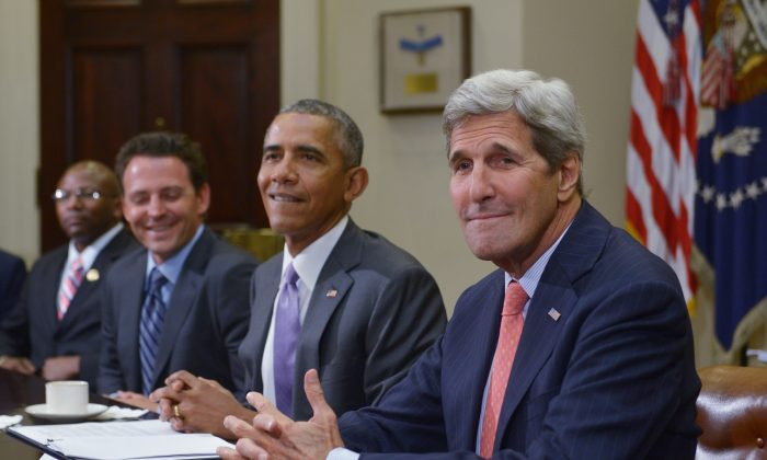 President Barack Obama (2R) and Secretary of State John Kerry (R) hold a meeting to discuss the Iran nuclear deal at the White House on Sept. 10. (Mandel Ngan/AFP/Getty Images)
