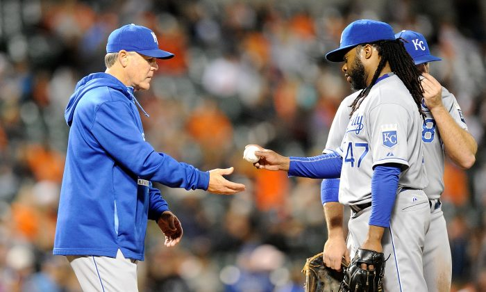 Johnny Cueto (R), who finished runner-up in the 2014 NL Cy Young voting when he was with Cincinnati, is just 2–6 with a 5.43 ERA since being traded to Kansas City. (Greg Fiume/Getty Images)
