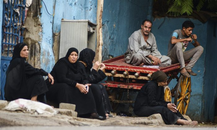 Relatives of an Egyptian victim who was killed in Sunday's incident in which Egyptian forces mistakenly opened fire on tourists in the western desert, wait at a morgue in Cairo, Egypt, Monday, Sept. 14, 2015. (AP Photo/Mohamed Elraai)