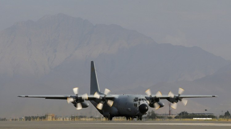 A Lockheed C-130 Hercules preparing for take off at the Kabul International airport, in Kabul. (ALEXANDER KLEIN/AFP/GettyImages)