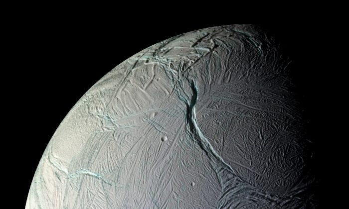 """""""If the surface and core were rigidly connected, the core would provide so much dead weight that the wobble would be far smaller than we observe it to be,"""" says Matthew Tiscareno. """"This proves that there must be a global layer of liquid separating the surface from the core."""" (NASA/JPL/Space Science Institute)"""
